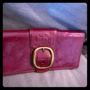 Beautiful never used maroon Coach clutch